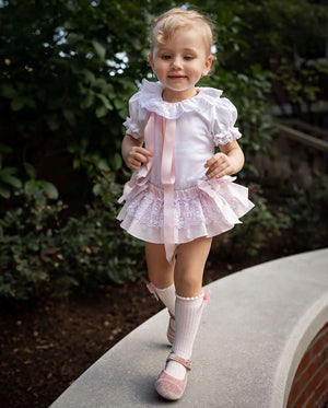 girl wearinf pibk lace baby bloomer and lace collar bodysuit