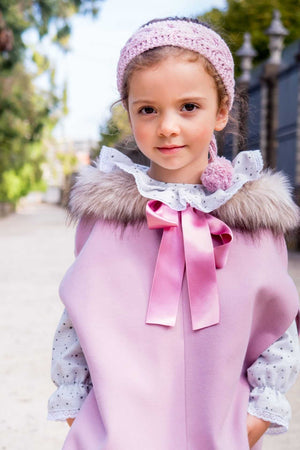 girl wearing pink cape with fur hood, made in portugal