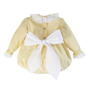 back of yellow baby romper with white bow, made in portugal