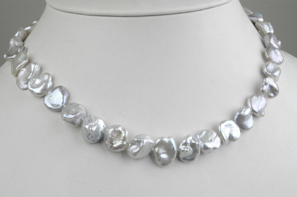 A necklace silver-hued keshi