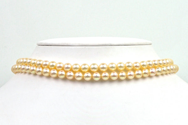 two strand lot of golden japan akoya pearls
