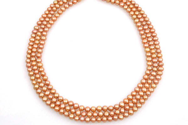 3 strands dyed coppery oval pearls