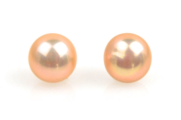 pair tangerine button pearls