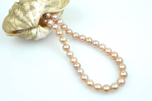apricot pink round pearl strand