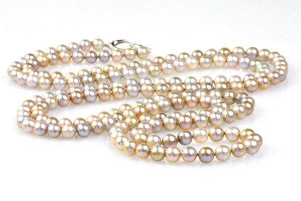 extra long necklace of pink pearls