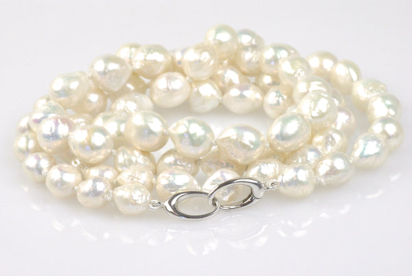 long necklace of white ripple pearls