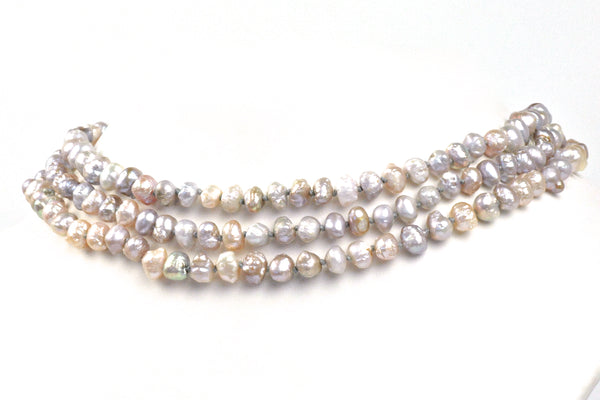 extra long necklace of rosebud pearls