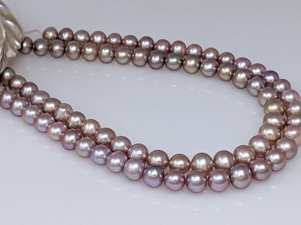 Natural mauve Chinese freshwater off round 10-11.0 mm pearl strand