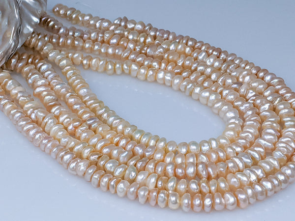 Soft Peach Stacked Chinese freshwater keshi strand 8.5-9.0mm
