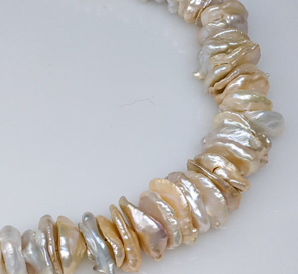 Stacked Chinese freshwater graduated baroque keshi strand 14-20mm