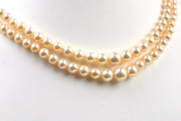 A necklace classic two-strand apricot graduated pearls