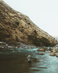 fly fishing near a mountain