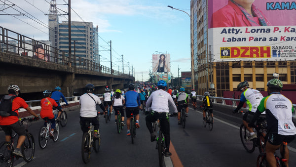 Cyclists along EDSA, Philippines during the Tour of the Fireflies 2014