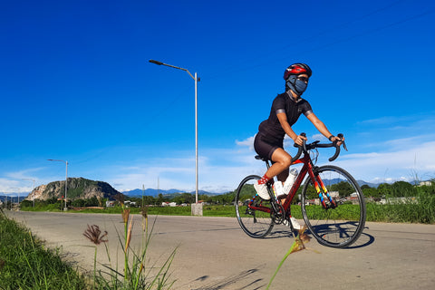 Kristina is riding her bike in full Ciclo Women's Apparel: Nightrider Jersey, Endurance Shorts, and Haru Socks