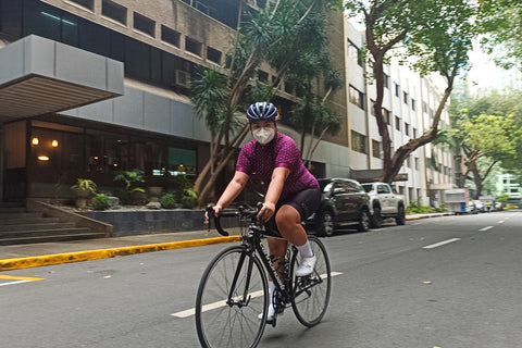 Maia wears the Ciclo Women's Arrowhead Jersey while riding her bike in Makati