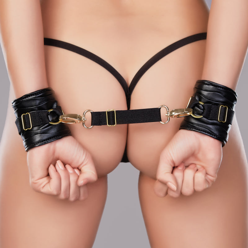 love bound wrist cuffs