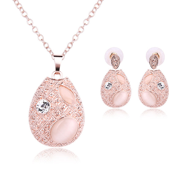 SPINNER Gold Pink Opal Jewelry Set