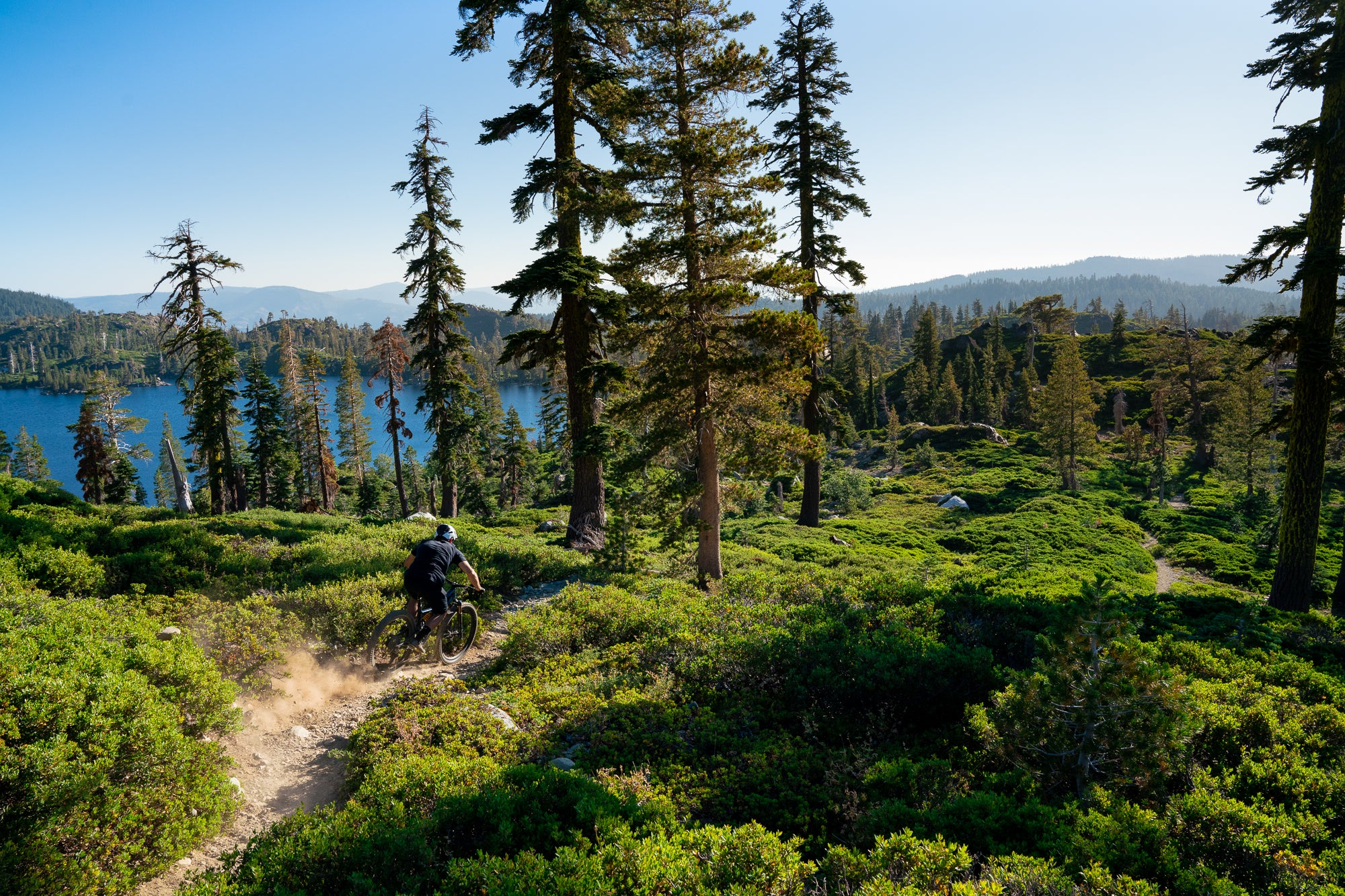Mountain Biker in the Sierra Nevada Mountains with Lake in the Background