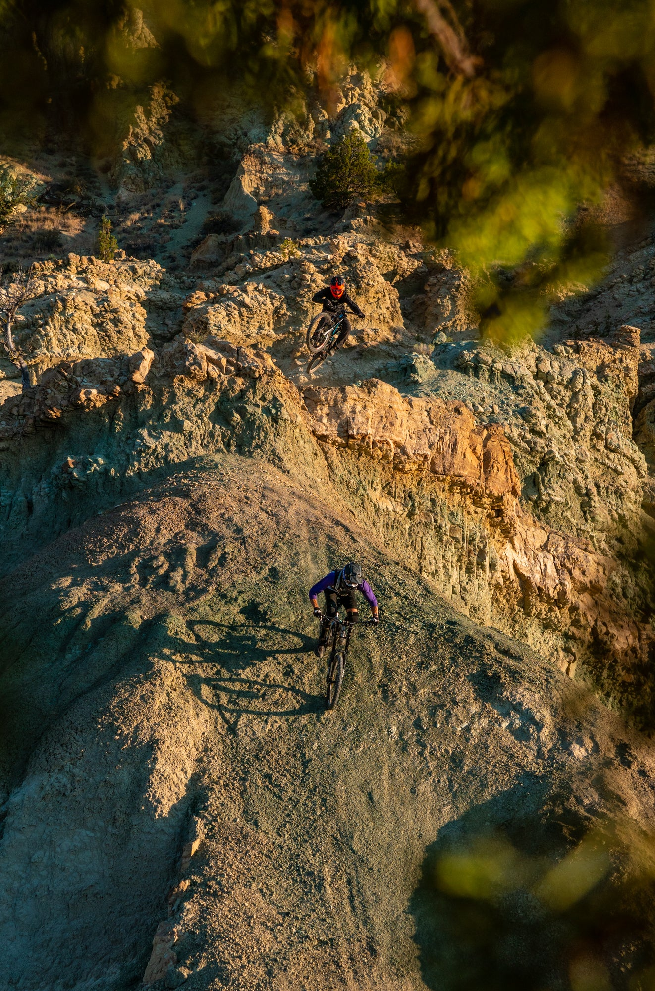 Two Mountain Bikers Riding Off a Large Jump