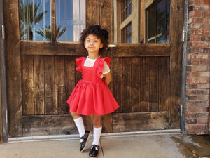 Girls Red Pinafore with Lace.