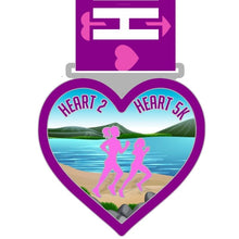 Load image into Gallery viewer, purple and pink running medal  in the shape of a heart with two runners and scenic ocean background