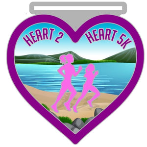 purple and pink running medal in the shape of a heart with two runners and scenic ocean background