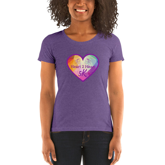 woman wearing a purple triblend t shirt with purple heart