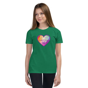 girl wearing a premium kelly green t shirt with purple heart
