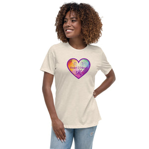 woman wearing a heather prism natural relaxed fit t shirt with purple heart