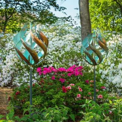 wind sculpture tulip garden art with blooming flowers