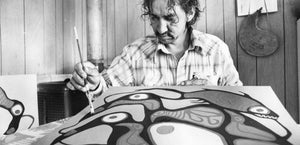 portrait of Norval Morrisseau painting a canvas of birds black and white image
