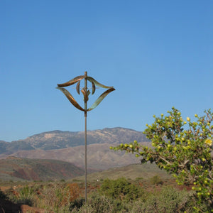 Whirly gig wind copper spinner in the desert by artist lyman whitaker