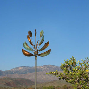 Agave flower metal kinetic wind spinner by artist lyman whitaker in the american desert landscape with bright blue sky