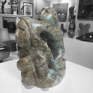 soapstone sculpture of sedna with shaman by master sculptor abraham ruben side view