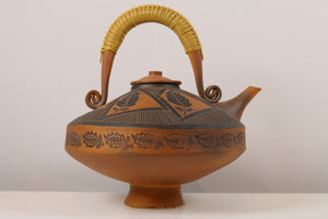 """Carousel Teapot with Leaves"""