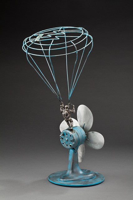 Peter McFarlane Reused Scrap Metal Sculpture with Parashute Man Landing on Re-purposed Fan
