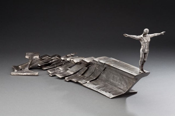 Peter McFarlane Reused Scrap Metal Sculpture with layered rail tyes made of reused polished whale with sculpted metal diving man