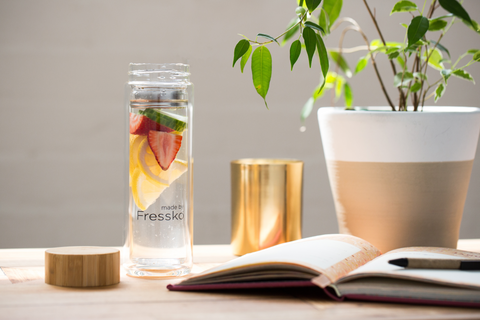 Made by Fressko glass infuser bottle with plant and book