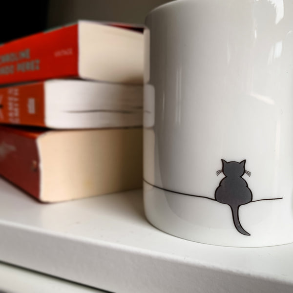 Crouching Cat Mug and Books