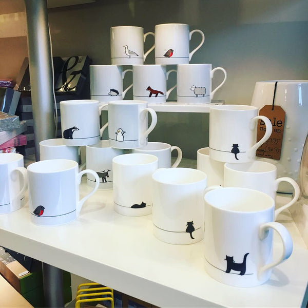 Jin Designs Mugs