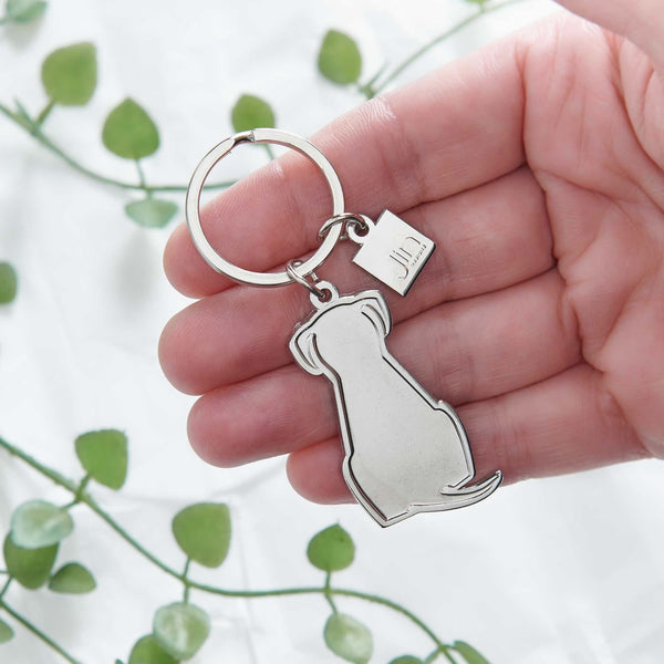 Sitting Dog Silver Keyring in hand