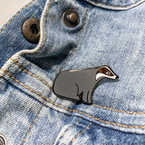 Badger Enamel Pin on Denim