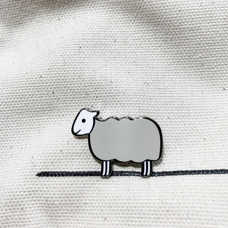 Sheep Enamel Pin on Material
