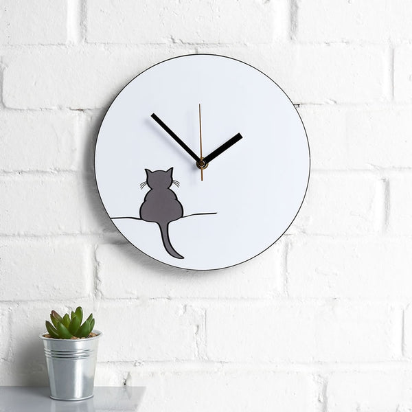 Crouching Cat Wall Clock on interior wall