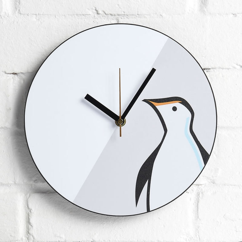 Penguin Wall Clock displayed on an interior wall