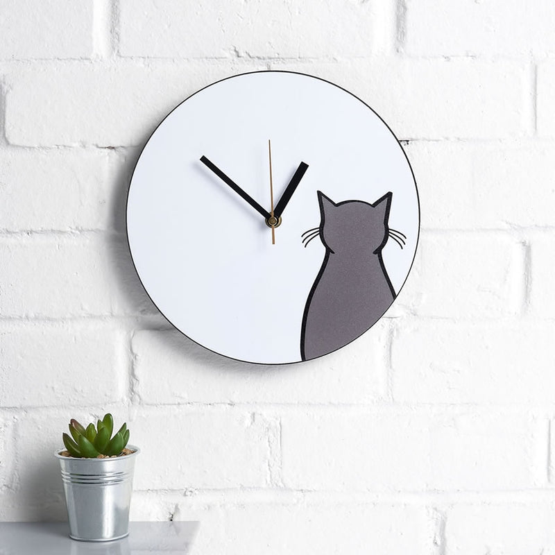 Sitting Cat Wall Clock on a kitchen wall