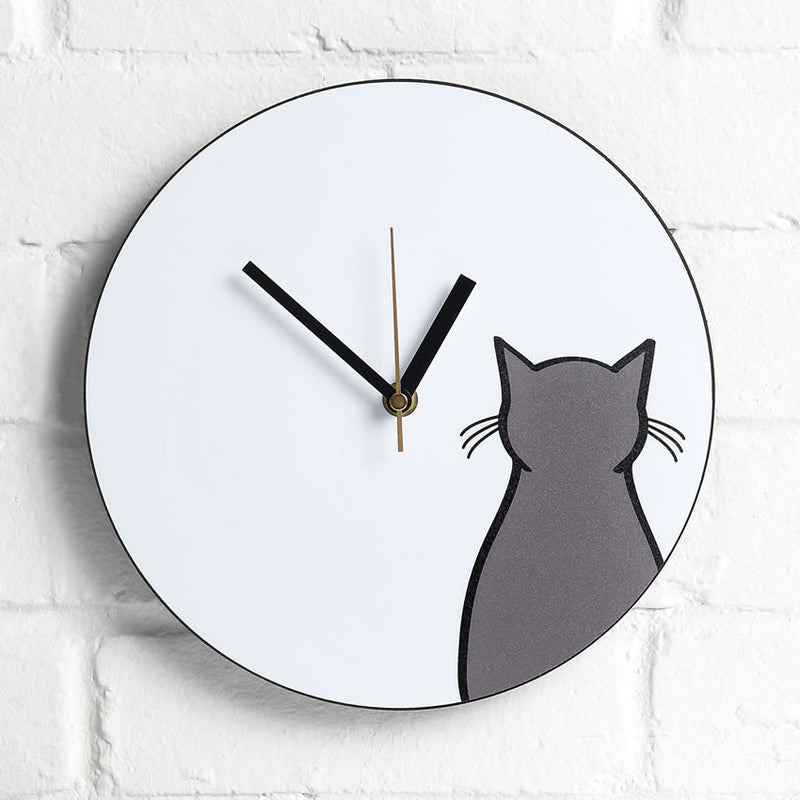 Sitting Cat Wall Clock on an interior wall