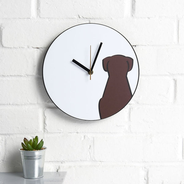 Sitting Dog Wall Clock on a kitchen wall