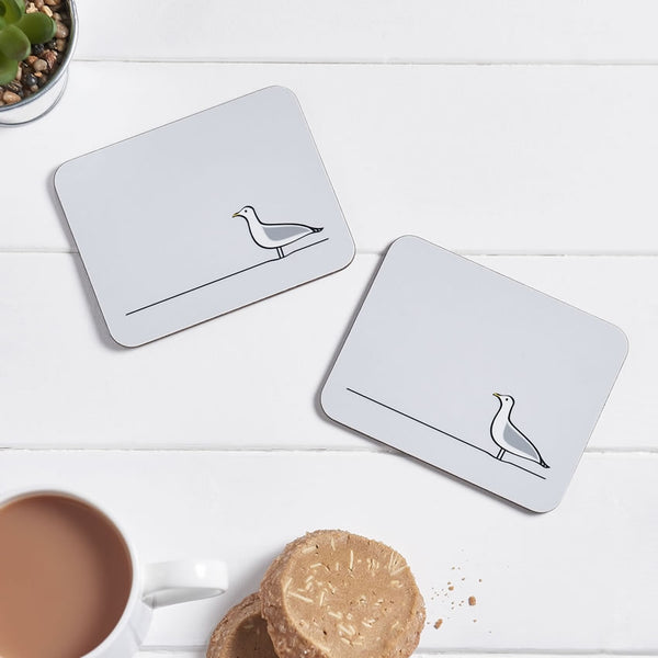 Seagull Coasters, Set of 2 with a cup of tea and biscuits