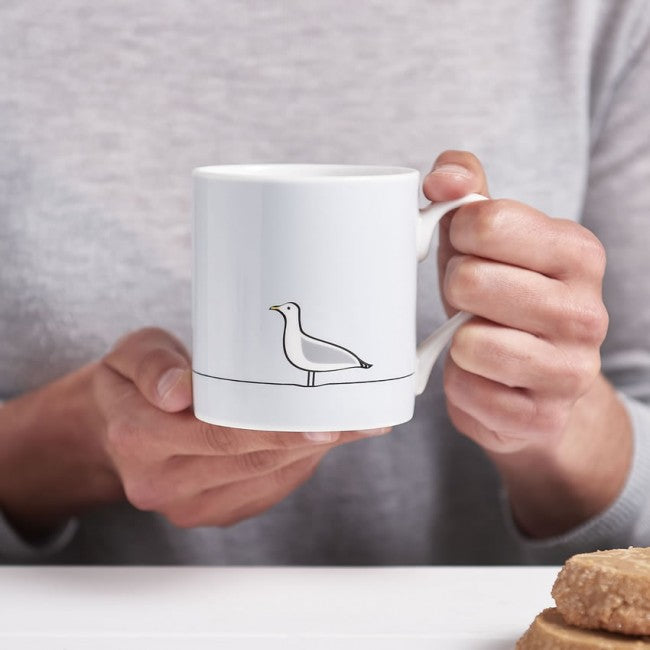 Seagull Mug in Hands